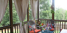 bring some shade to your porch with cheap canvas drop cloths, outdoor living, porches, Porch AFTER with drop cloths curtains and colorful new cushions and decor
