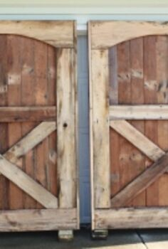 making barn doors from barn floors, doors, repurposing upcycling, woodworking projects, Our barn doors after assembling them from old oak barn floor boards They are each 6 wide and 8 tall The old floor boards came this clean simply with a 3000 psi power washing