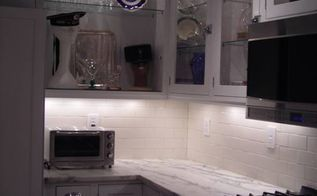 kitchen lighting makeover a stunning transformation, home decor, kitchen backsplash, kitchen design, lighting, Custom cabinets with puck under cabinet lighting