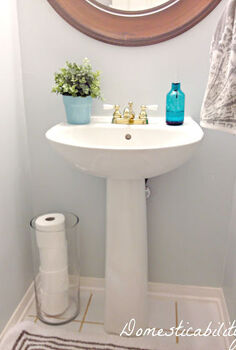 pretty toilet paper storage solutions, bathroom ideas, cleaning tips, organizing, Use a tall cylinder vase to store toilet paper