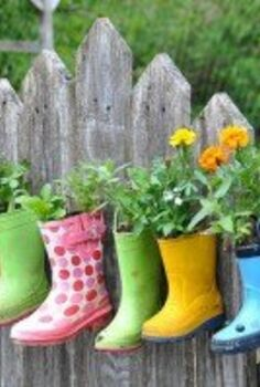 how to create a colorful and family friendly backyard, gardening, outdoor living, It just so happens that we are in the middle of spring cleaning which is perfect timing for this fun decorative upcycled planter idea for the kids I ll be pulling all of last years rain boots for this project and go looking for pai