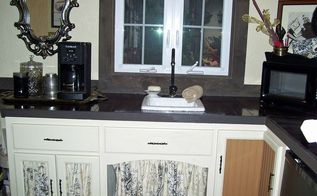a countertop that looks great and doesn t break the bank, countertops, laundry rooms, Just a picture to give you an idea of how to use the fabric and also the same beadboard on another door