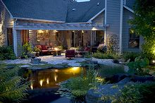 create a romantic summer evening with underwater lighting, outdoor living, ponds water features, Pond lighting casts a cozy glow beneath the surface of the pond