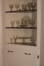 homemade corner cabinet, diy, kitchen cabinets, woodworking projects, The finished cabinet It is essentially a three cornered frame where the frame supports the shelves You can add bead board or any other type of backing