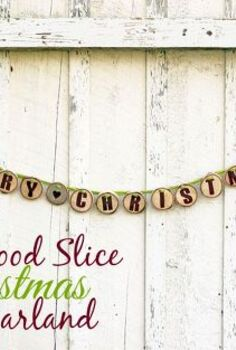 merry christmas wood slice garland, christmas decorations, crafts, seasonal holiday decor, Cut rounds of a log use paint to stencil letters on drill holes and tread a ribbon through EASY to create this Christmas Garland