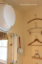 decorating a small bathroom, bathroom ideas, home decor, small bathroom ideas, There s something about a grouping of almost anything that makes an impact Here is a column of vintage hangers