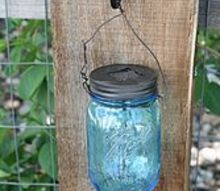 diy mason jar solar lights, crafts, mason jars, repurposing upcycling, I attached one to each fence post It looks really beautiful at night and pretty in the daytime too