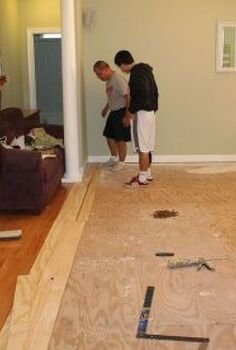 laying plywood floors, flooring, woodworking projects, Beginning to lay the plywood planks