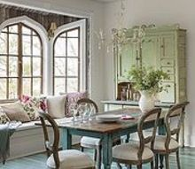 house tour a lively cottage revival, architecture, home decor, The aged to perfection dining table in a vivid aqua hue and the stunning sage cupboard give the dining room old school charm
