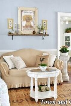 adding spring to the living room, home decor, living room ideas, Touches of greenery and a new French Boulangerie sign lighten the room decor for spring