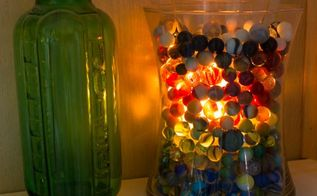 how to make your own candles in the microwave, crafts, Candle light shining through vintage glass marbles