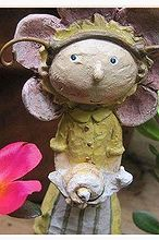 a little whimsy, gardening, Lisa likes snails Notice her hair she looks like a little bug herself
