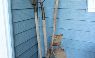 vintage garden farm tools are perfect for a junk garden, flowers, gardening, Put some long handled tools in a rusty milk can