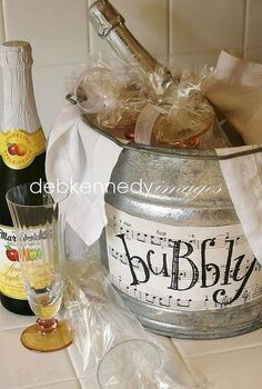 bubbly in a bucket, crafts, slip champagne glasses into clear cello gift bags and tie with ribbon then tuck them into a bucket filled with ice and a sparkling beverage