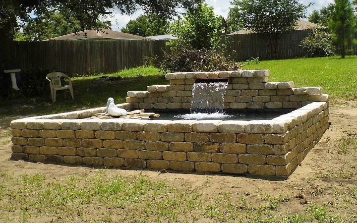 raised formal koi pond and patio hometalk