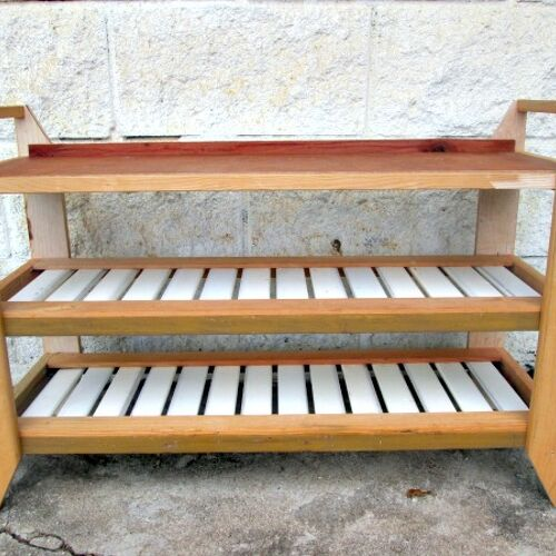 I built this small shoe bench for under $5 using reclaimed wood, but I am not sure if I should paint, stain, or leave it the way it is.