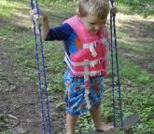 diy make a swing out of an old skateboard, diy, how to, outdoor living, repurposing upcycling, OK I know some of you are wondering why Johnnie has a lifejacket on He came from the pool to try out the new swing
