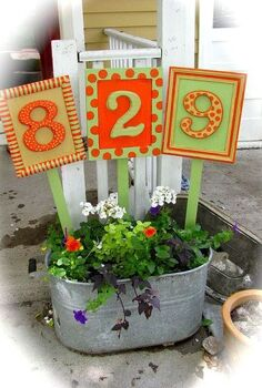 house numbers, crafts, Plants have now grow up to be nearly as tall as the bottom of the frames and the vines have spilled over and onto the walk