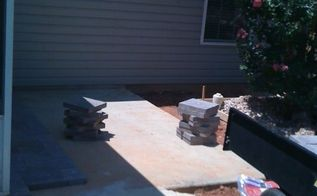 enlarging my patio, concrete masonry, diy, patio, After the form was made I mixed and poured two bages of concrete at a time