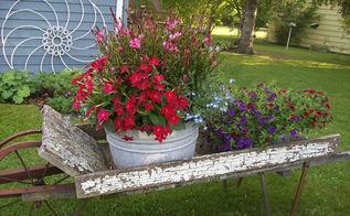 the secret to great junk garden vignettes, flowers, gardening, repurposing upcycling, An old hay rake flower