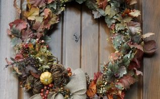 fall wreath giving fall a front door welcome, crafts, seasonal holiday decor, wreaths, This started with a simple grapevine wreath after adding a couple of inexpensive garlands and a few fall pics a burlap bow it s a perfect welcome to friends and family