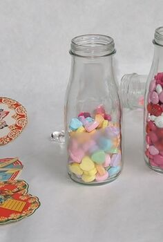 quick cheap valentine candy holder, crafts, repurposing upcycling, seasonal holiday decor, valentines day ideas, This is how they will look with candy in them hearts do not show up too well but you can buy big bags of candy which is cheaper and pour the candy in the bottles