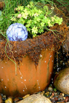container water gardens, outdoor living, patio, ponds water features, A whimsical dripping pot adds fun to your garden Add a glass globe for visual interest