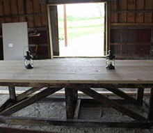 12 reclaimed barn wood trestle table, diy, woodworking projects, Table top glues up and ready to be finished