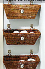 window boxes for bathroom storage, bathroom ideas, storage ideas, Using decorative hooks from the hardware aisle at Lowe s I secured each window box to the wall