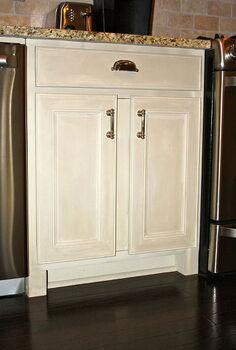 making a kitchen cabinet more functional, kitchen cabinets, shelving ideas, The only piece he added to the cabinets was the center strip of wood to hide the middle strip that he removed