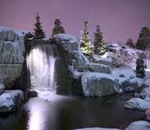 explore an icy waterfall and grotto in st charles illinois, ponds water features, The waterfalls at night with the light shining through the waterfalls This water feature is located at Aquascape s corporate headquarters