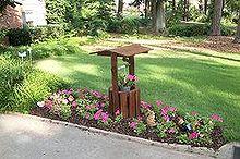 my attempt at creative gardening, gardening, wishing well in a petunia garden