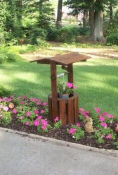 my attempt at creative gardening, gardening, wishing well in a petunia garden