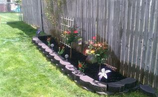 rose garden w 2 new playboy rose trees added amp few matching tulips, gardening