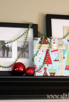 gift wrapped photo gallery wall, seasonal holiday decor, wall decor, Draping colorful strands of beads is a fun way to bring some festive flare to the display without covering up all of your photos