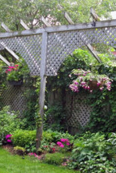 privacy screen ideas and how to make a fence taller, fences, outdoor living, If a fence is at the maximum height allowed another option is to put a taller structure within the yard like this one There were townhouses in the yard behind and this really helped obscure the view