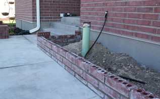 q new brick planter, concrete masonry, landscape, its just a short planter the cap will create one more course high