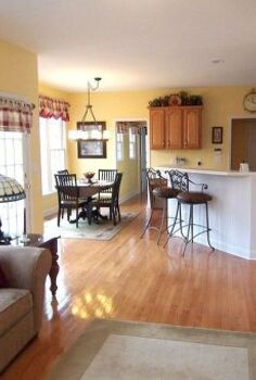 if you want to make your kitchen look larger then paint both rooms the same color, home decor, kitchen design, painting, After picture showing the kitchen and the family room appearing larger