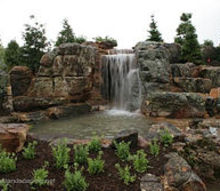 world s most extreme ecosystem fish pond construction by certified aquascape, go green, outdoor living, patio, ponds water features, Finished Aquascape Ecosystem Fish Pond Waterfall Pond Behind these Waterfalls is a Cave Constructed by the largest group of professional Pond Builders in the World Certified Aquascape Contractors