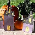diy haunted house treat bags, crafts, halloween decorations, seasonal holiday decor, Make bags in different heights for an eye catching centerpiece display