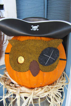 felt hand stitched pumpkin masks, seasonal holiday decor, A Dollar Tree Pirate hat with the pirate owl mask