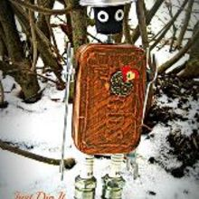 transforming 2 regular altoids boxes into a functional robot, crafts, repurposing upcycling, Altoids box in the snow isn t he cute and you never know when you are going to need a wrench or two