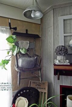 mantel refresher chair on the wall and paper flowers, home decor, Placing a rustic child s wooden chair on the wall with a tea kettle planter