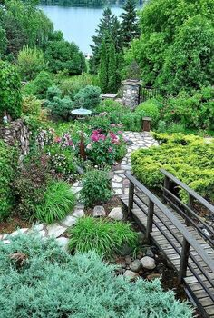 stroll through the garden, flowers, gardening, outdoor living, perennial, ponds water features, Bridge over the pond and stone walkway through the peonies