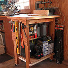 organized garage and workshop, garages, organizing, storage ideas, Rolling power tool work bench houses all the small power tools
