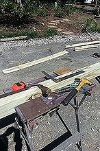 instructions for pergola for under 20, diy, outdoor living, woodworking projects, After cutting all 4 2x4s 7ft in length measured where I wanted inside bracing 1x6 pickets and traced outside edges of picket to notch out where the bracing goes for a professional look