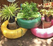 my colorful tires, gardening, repurposing upcycling, I finally had some time to spray paint old tires to add color to my back yard