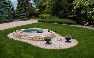 before a fountain after a pondless waterfall with bronze statuary, gardening, ponds water features, A close up of the formal fountain Notice the lush vegetation behind the fountain You cannot see the home behind it