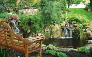 can retaining walls be beautiful as well as functional, gardening, landscape, outdoor living, ponds water features, pool designs, Backyard Stream and Waterfall Bill Renter used moss rock boulders to support his front yard s two waterfalls one close to new bench the other at the end of 85 foot stream