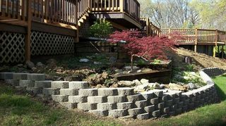 q i have a retaining wall made of railroad ties that has rotted what advice do you, concrete masonry, outdoor living, wall decor